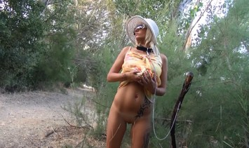 Voyeur video of a provocative blonde girl outdoor